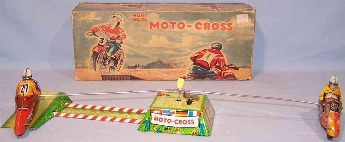 huki kienberger 8/5 tin toy motorcyclist motocross ride in circles over ramp
