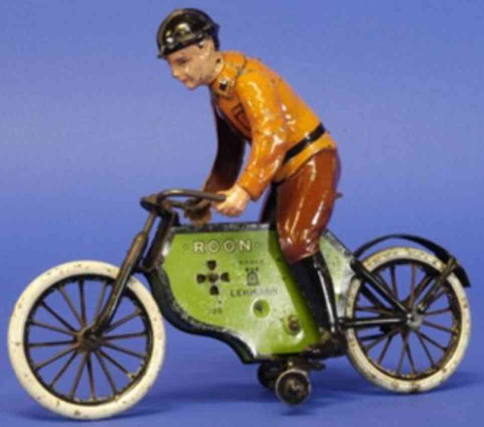 lehmann 726 roon tin toy motorcycle motorcyclist with training wheels orange brown green