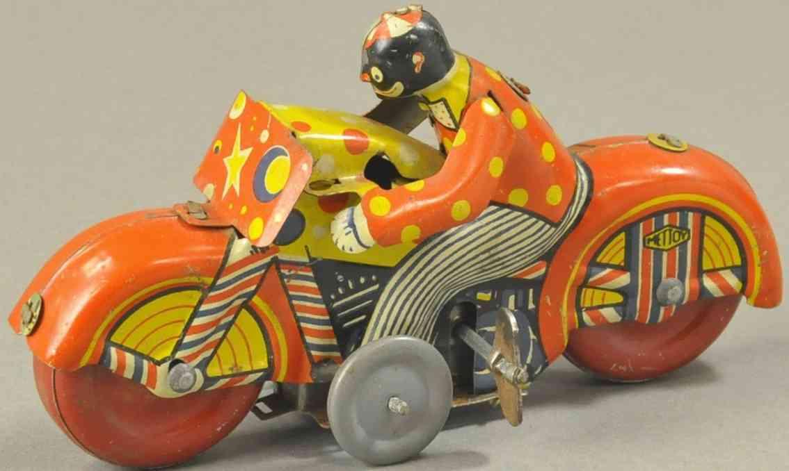 mettoy blech spielzeug junge auf motorrad uhrwerk
