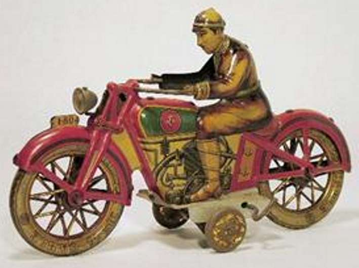 PAYA Motorcyclist lithographed tin