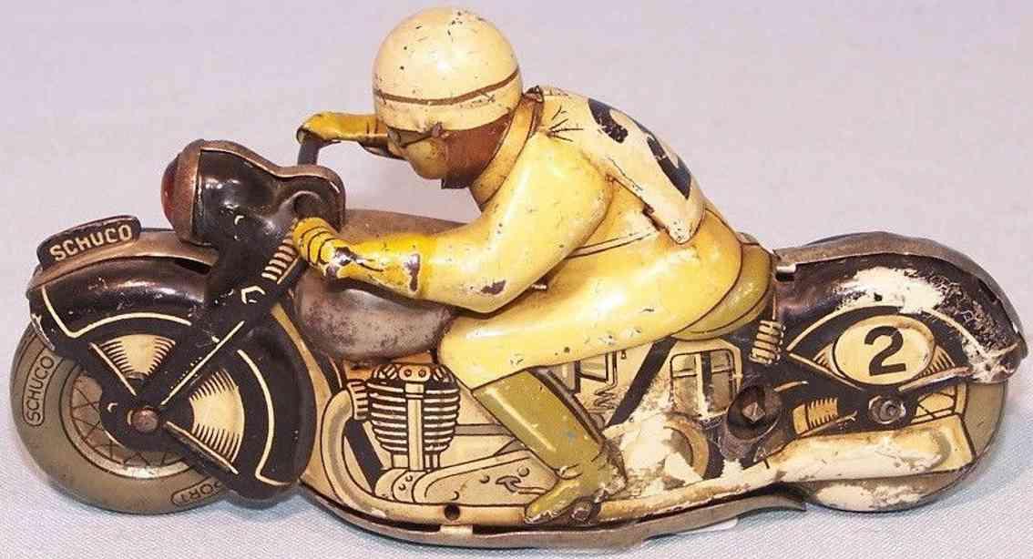 schuco 1012 blech spielzeug sport-motorradfahrer uhrwerk gelb