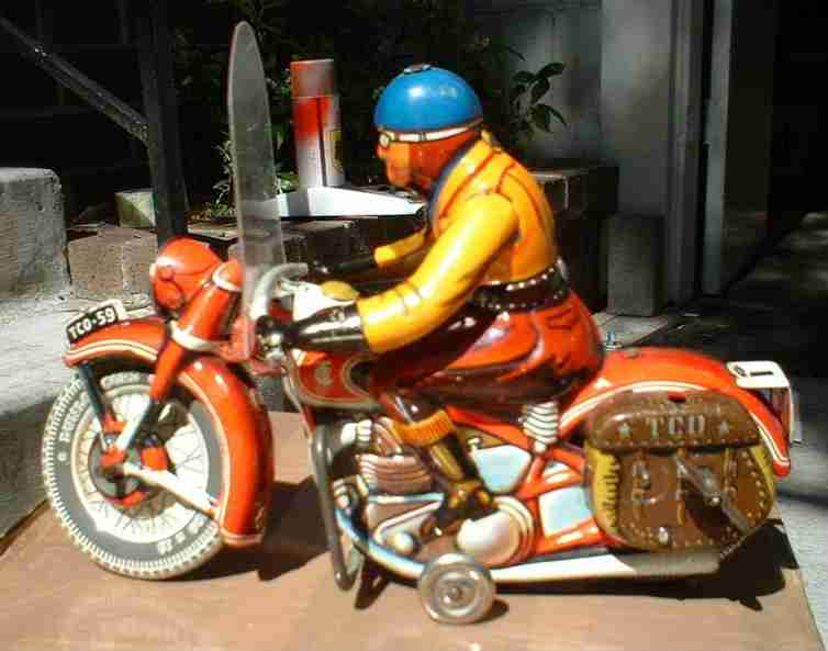 tippco 590 tin toy motorcyclist with saddle bags clockwork