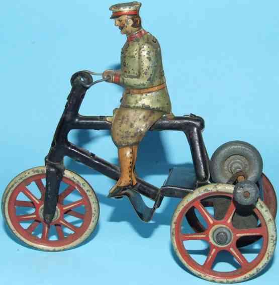 Dreirad mit Fahrer lithografiert mit Friktionsantrieb