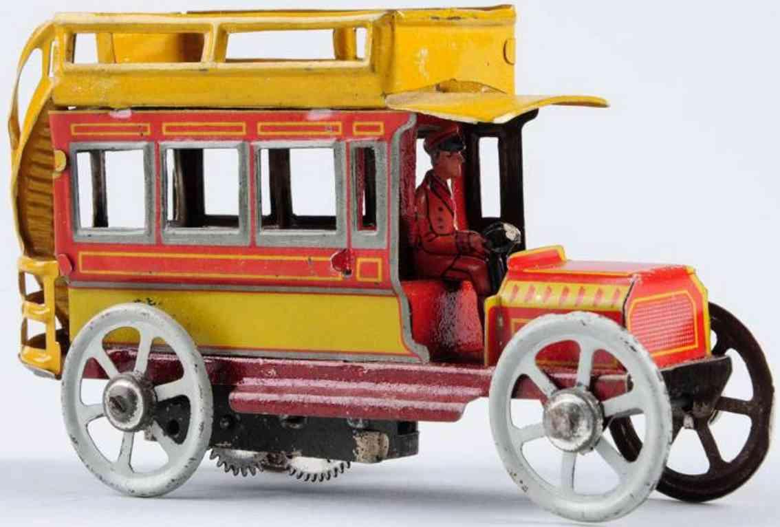 distler penny toy double decker bus clockwork driver red yellow grey