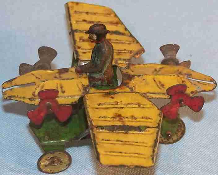 distler blech penny toy flugzeug mit seitenpropellerapparat gelb gruen