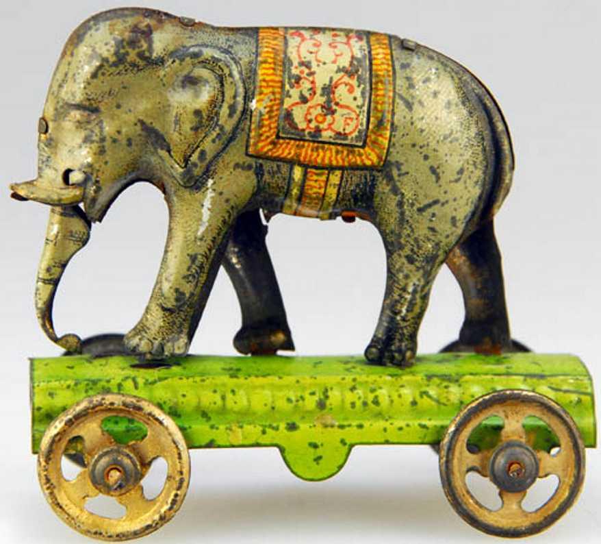 fischer georg tin penny toy the elephant green platform wheels