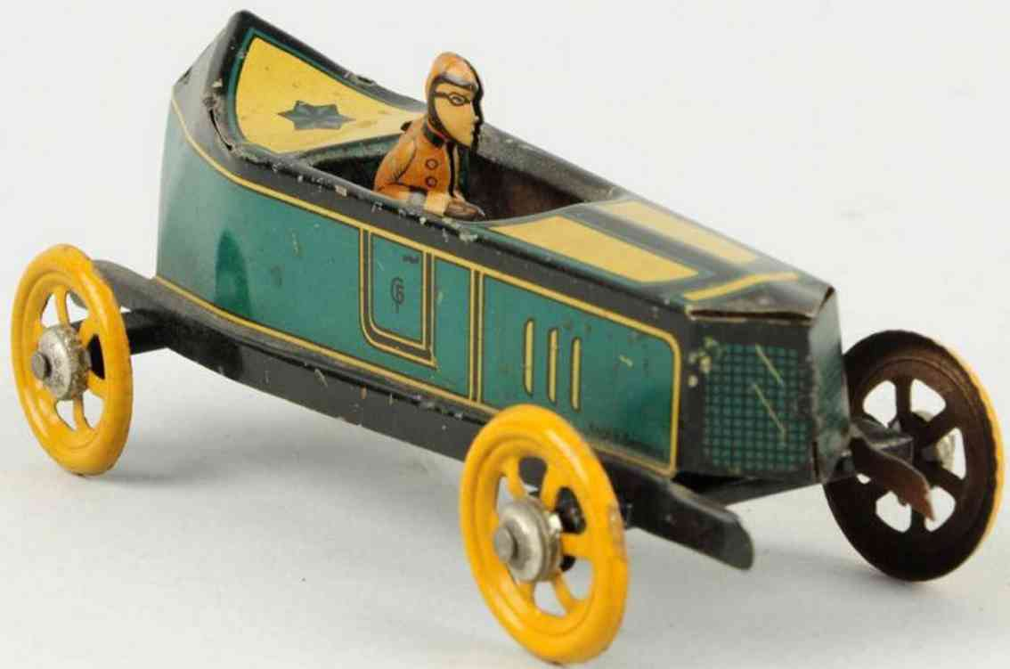 fischer georg tin penny toy boat tailed race car driver green yellow