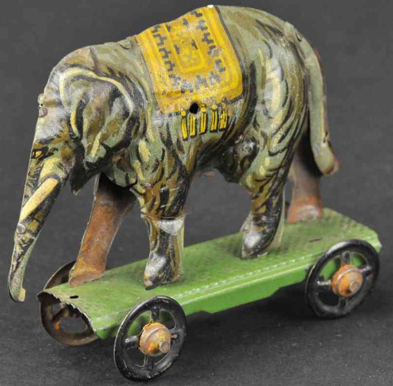 georg fischer penny toy elephant on platform wheels tin