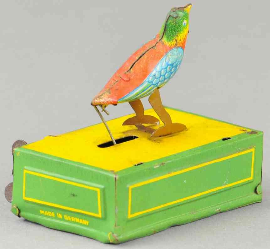 issmayer penny toy wind-up bird tin green yello red blue