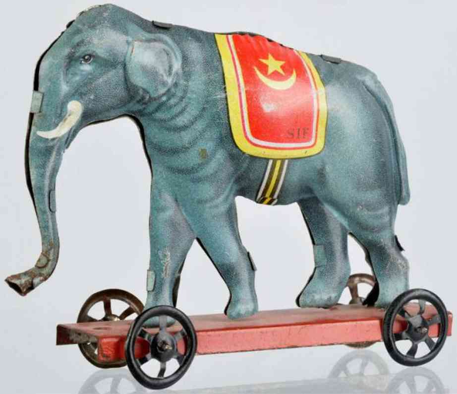 JEP Penny Toy Elephant on platform litho tin