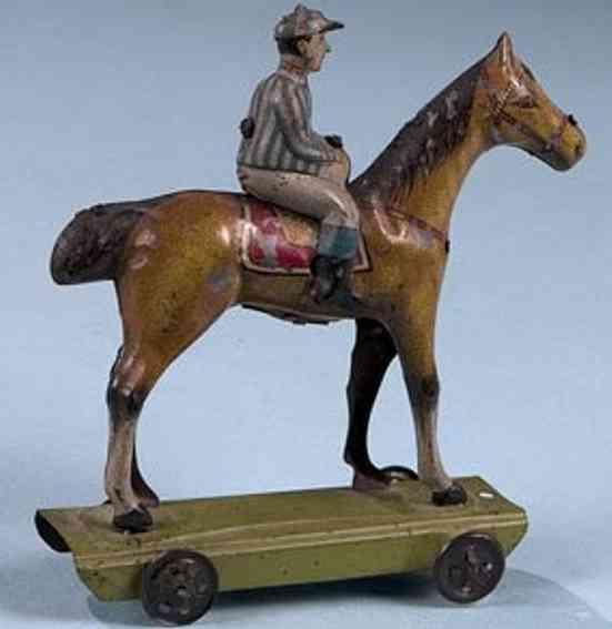 levy george gely penny toy jockey mit pferd auf plattform raeder