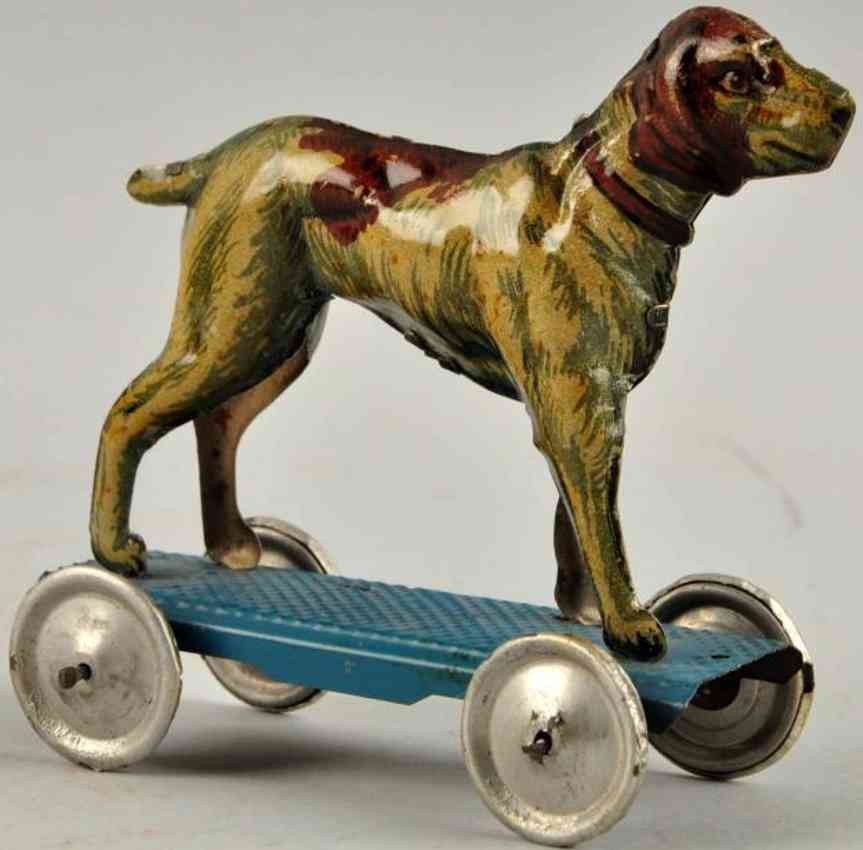 meier penny toy dog on blue platform with nickeld disc wheels