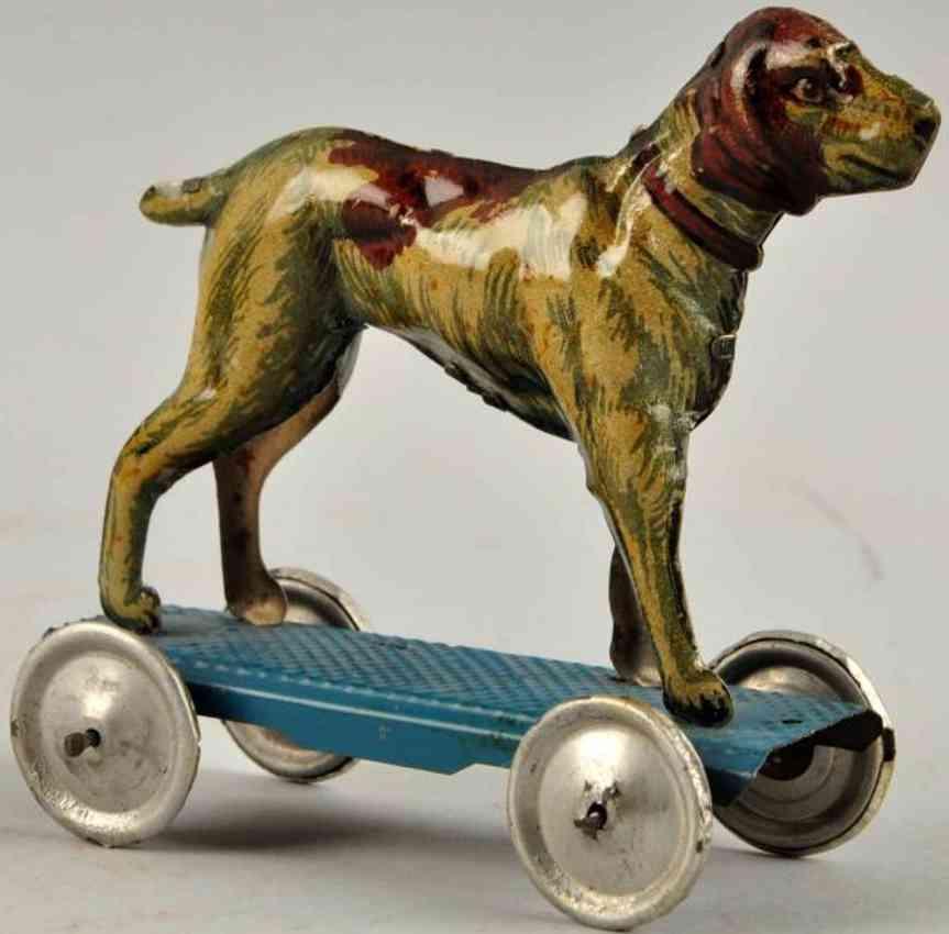 meier penny toy hund auf blauer plattform mit vernickelten scheibenraedern