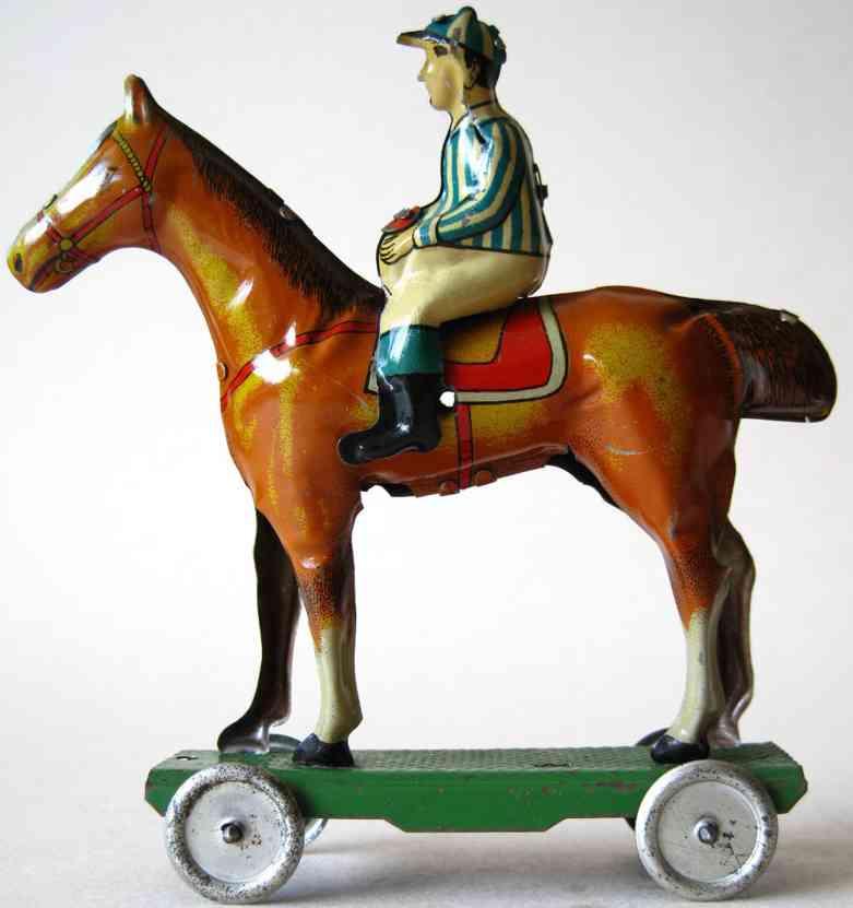 meier tin penny toy jockey on horse platform