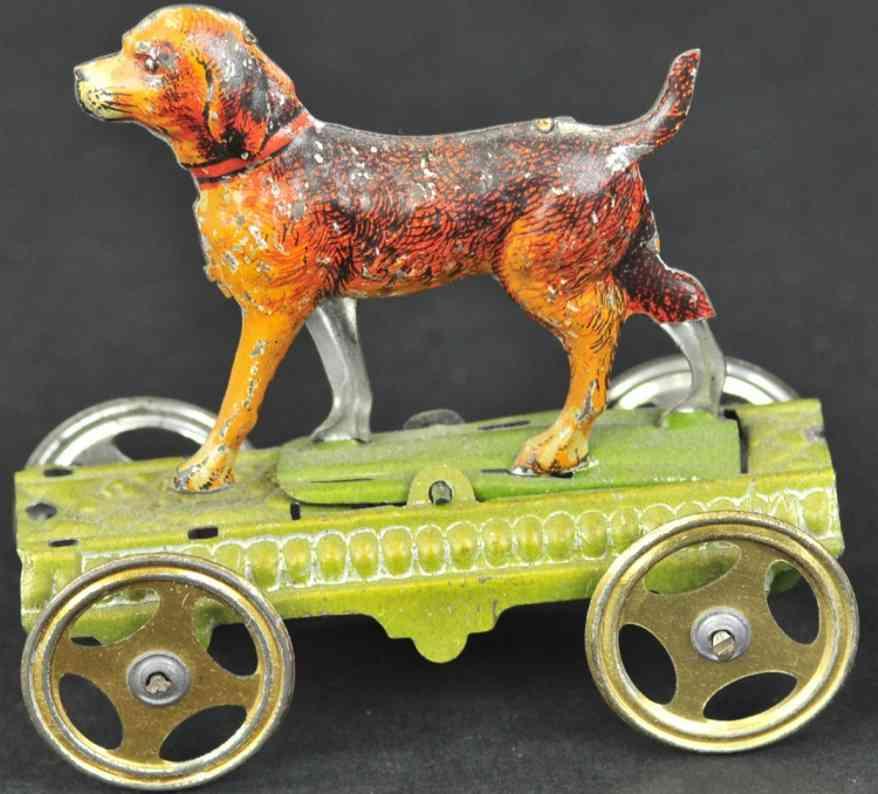 meier blech penny toy hund auf gruener plattform