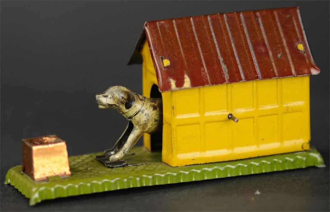 maier hermann nuremberg penny toy mechanical dog in yellow kennel on green platform