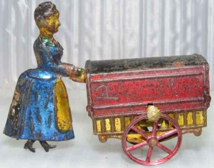 charles rossignol penny toy frau mit handkarre und schwungradantrieb
