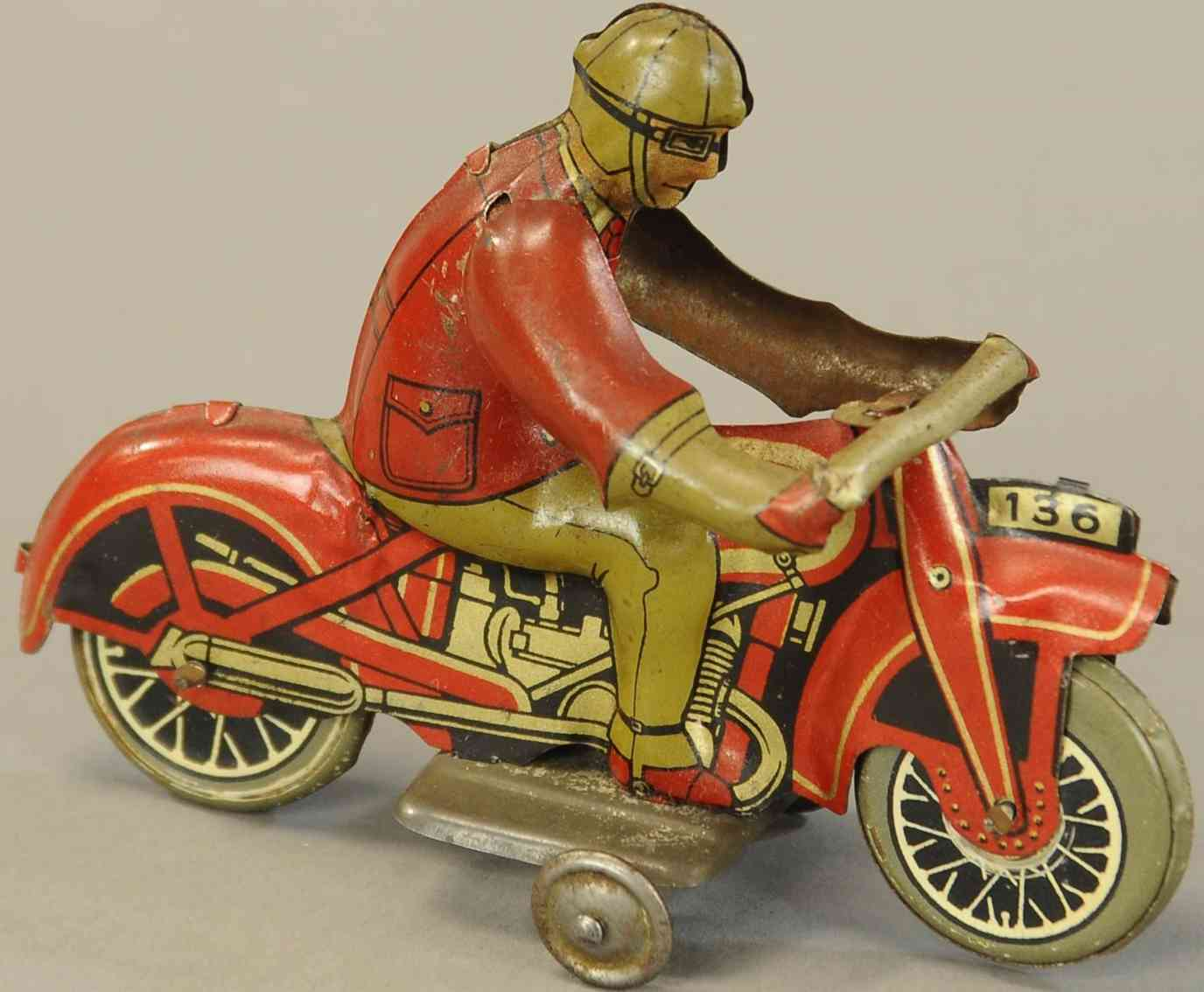 136 penny toy motorcycle with driver in red