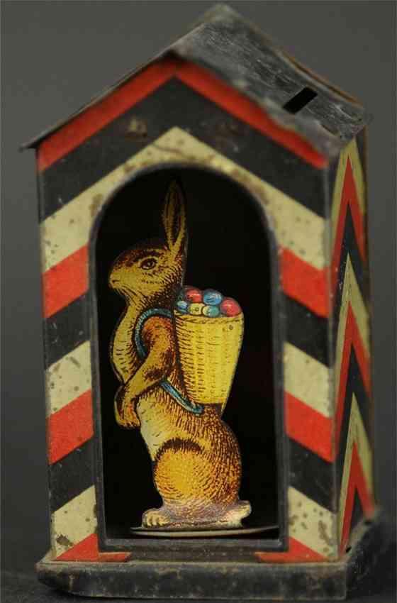 penny toy rabbit in doorway as bank