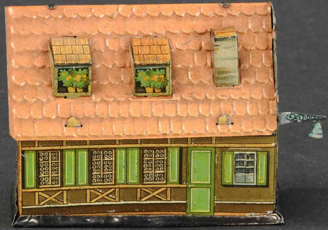 penny toy haus zwei dachgauben ein kamin glocke als spardose