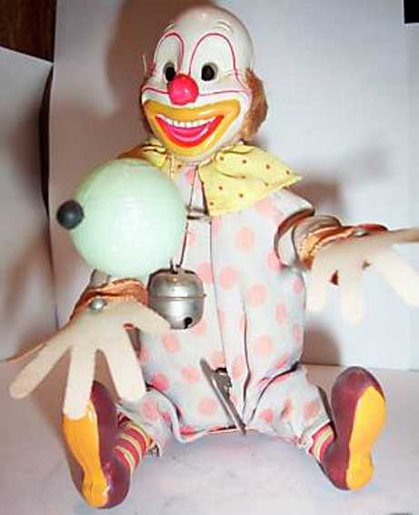 alps celluloid toy clown celluloid clown with wind-up mechanism, juggles the ball bac