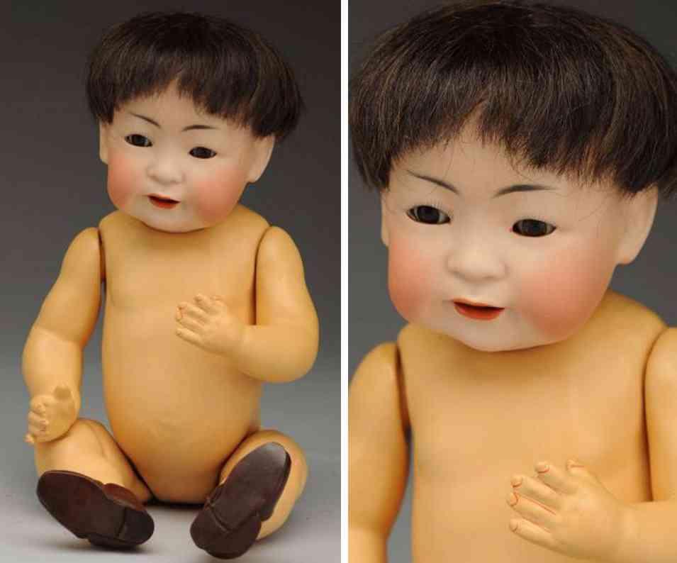 kestner jdk f 10 243 porzellankurbelkopfpuppe orientalisches baby