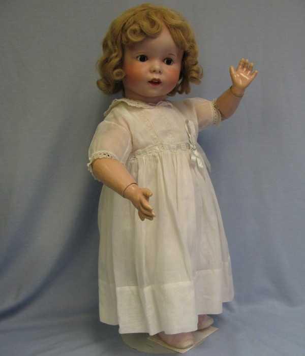 SFBJ 21 247 Lachende Charakter Kleinkindpuppe