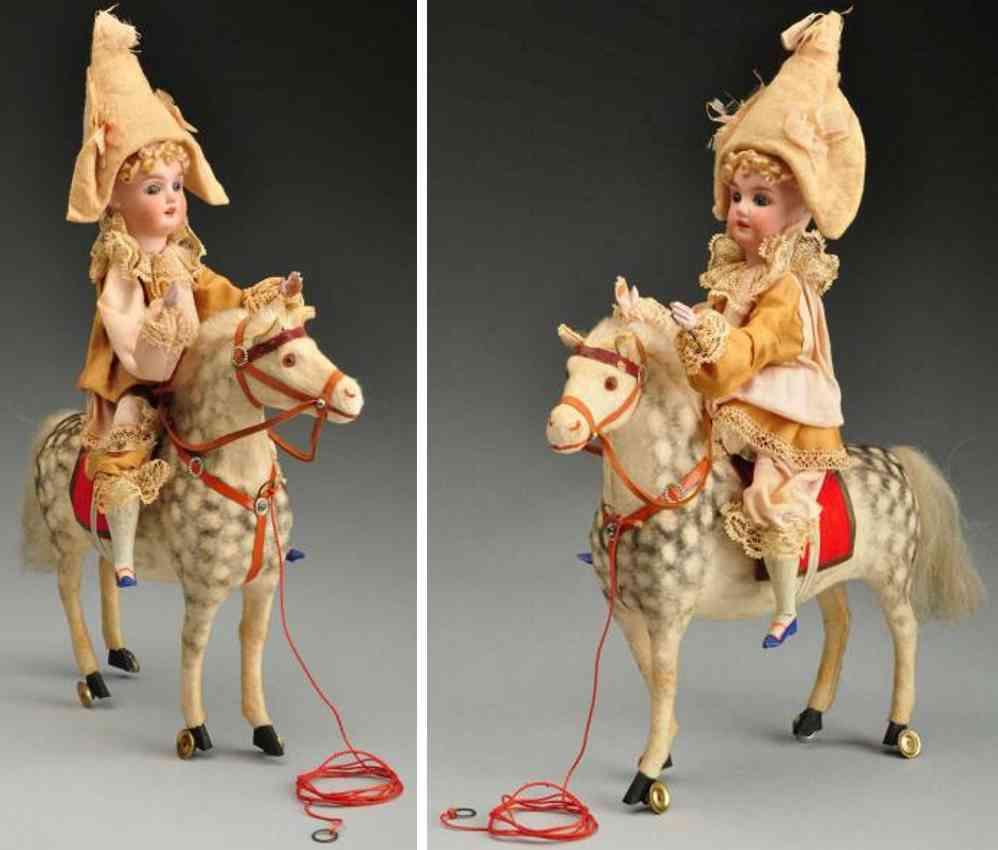 Schönau & Hoffmeister 4600 10 Clown mit Porzellankopf auf einem Pferd sitzend