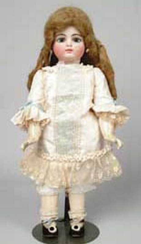 F.10G. Closed mouth French child doll