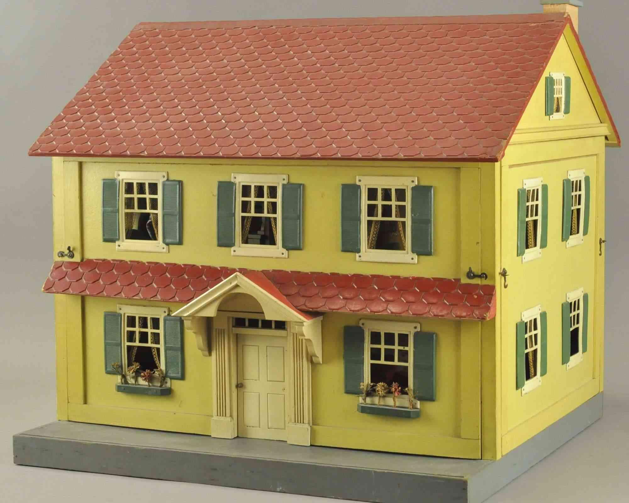 schoenhut gelbes zweistoeckiges puppenhaus aus pressspan