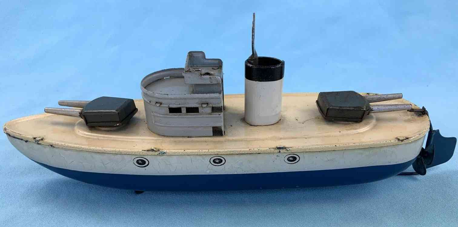 arnold tin toy warship with clockwork drive