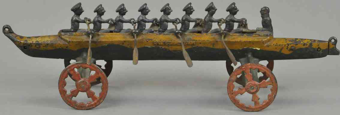 us hardware co cast iron toy eight men racing scull