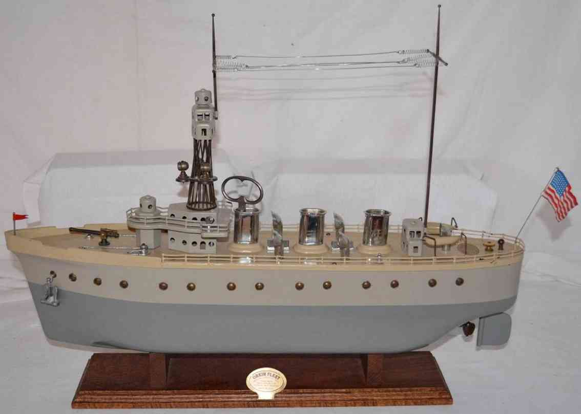 orkin pressed steel toy  battleship clockwork