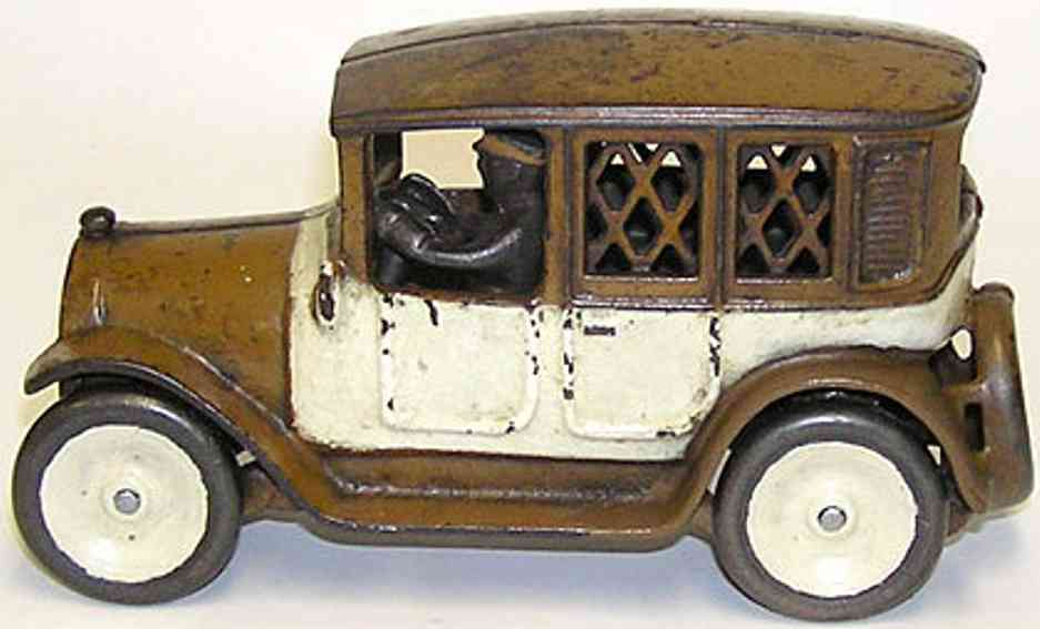 arcade cast iron toy brown white checker cab bank driver