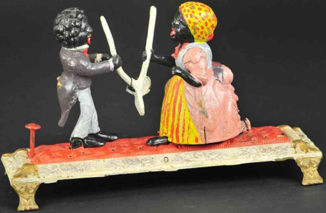 bailey charles spielzeug gusseisen spardose zwei figuren wuenschelrute mann frau