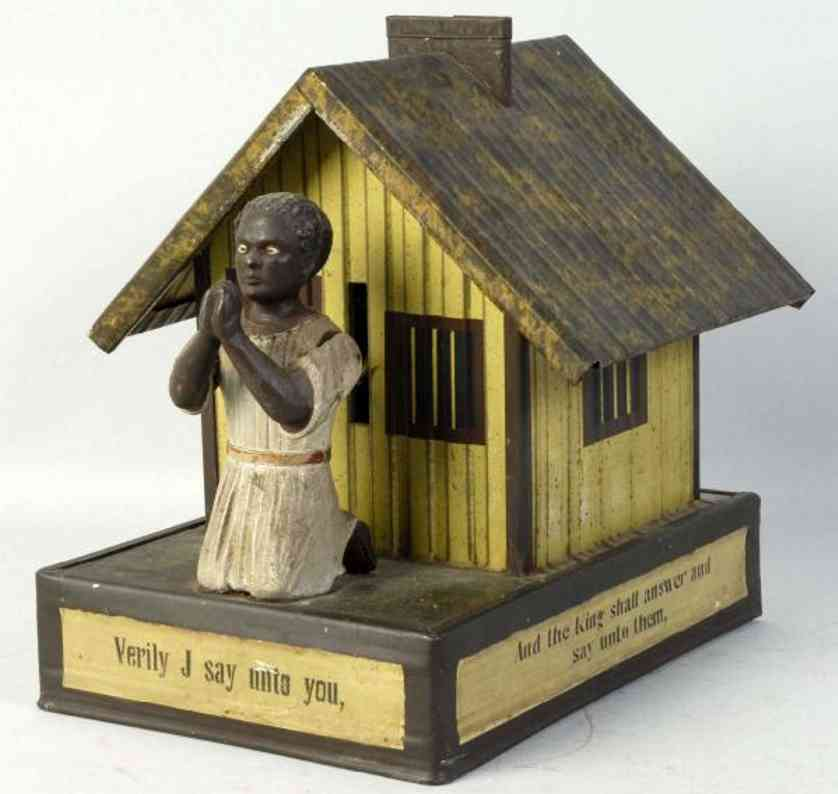 bing cast iron toy african american playing cards bank praying woman