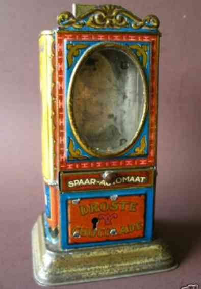 droste tin toy mechanical bank mechanical chocolate vending bank  in gold, blue, red and in