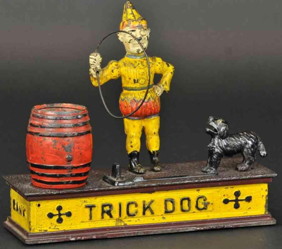 hubley gusseisen spardose trick hund gelb braun rot