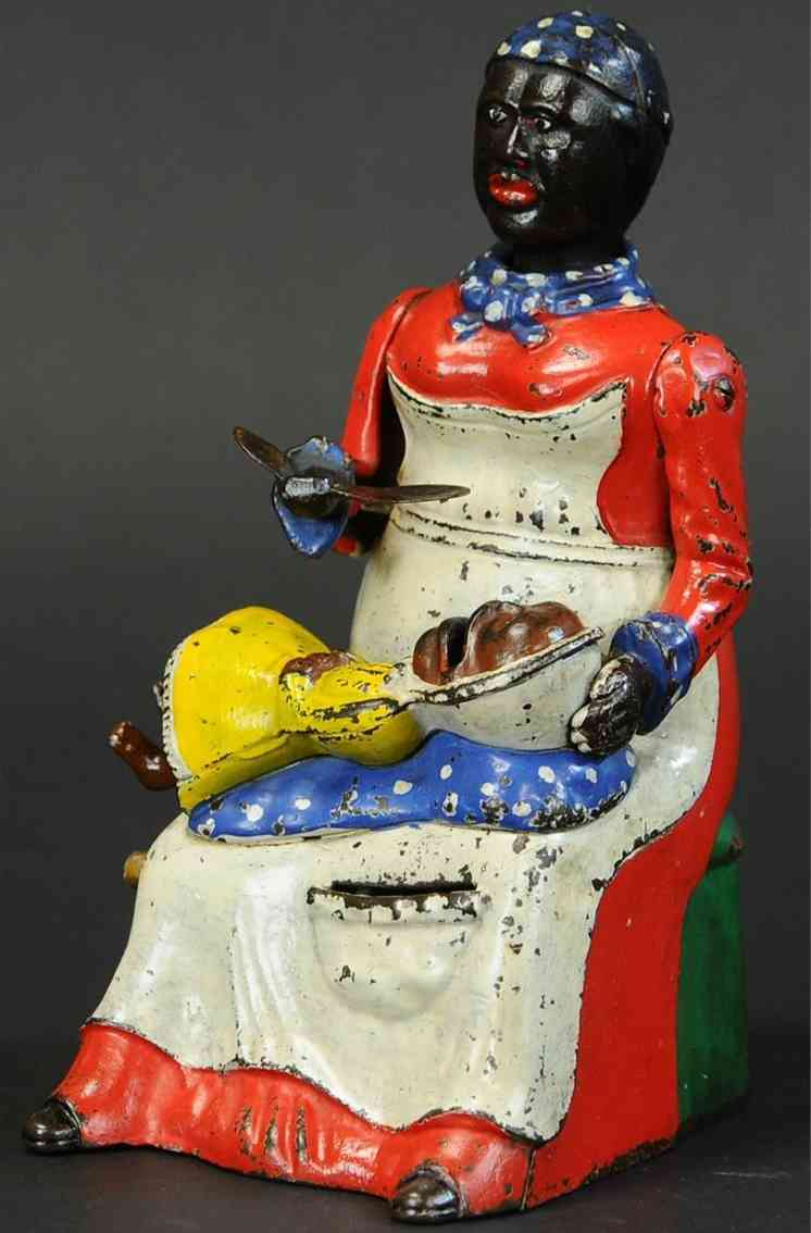 kyser & rex cast iron toy mammy and child bank red and yellow dress