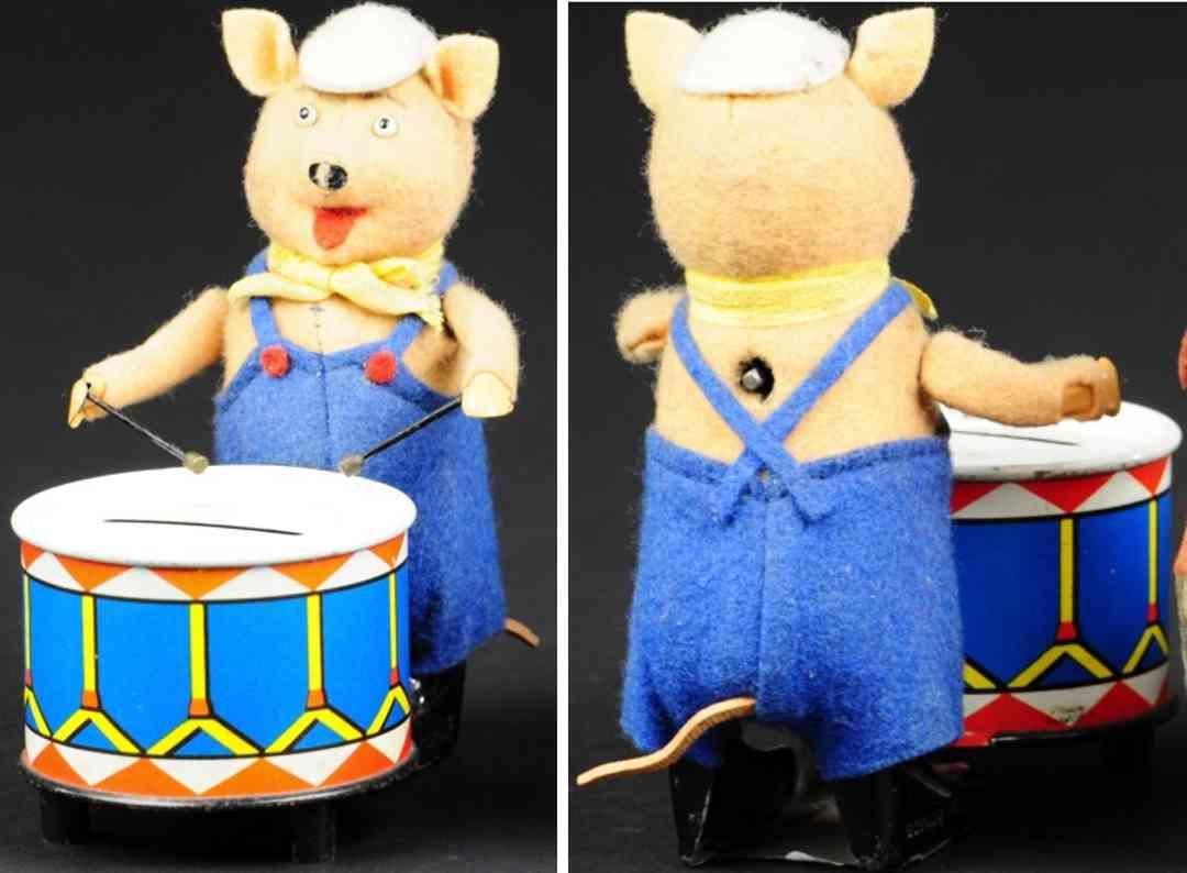 schuco 980/5 blech spielzeug spardose schweinchen mit trommel als sparbuechse