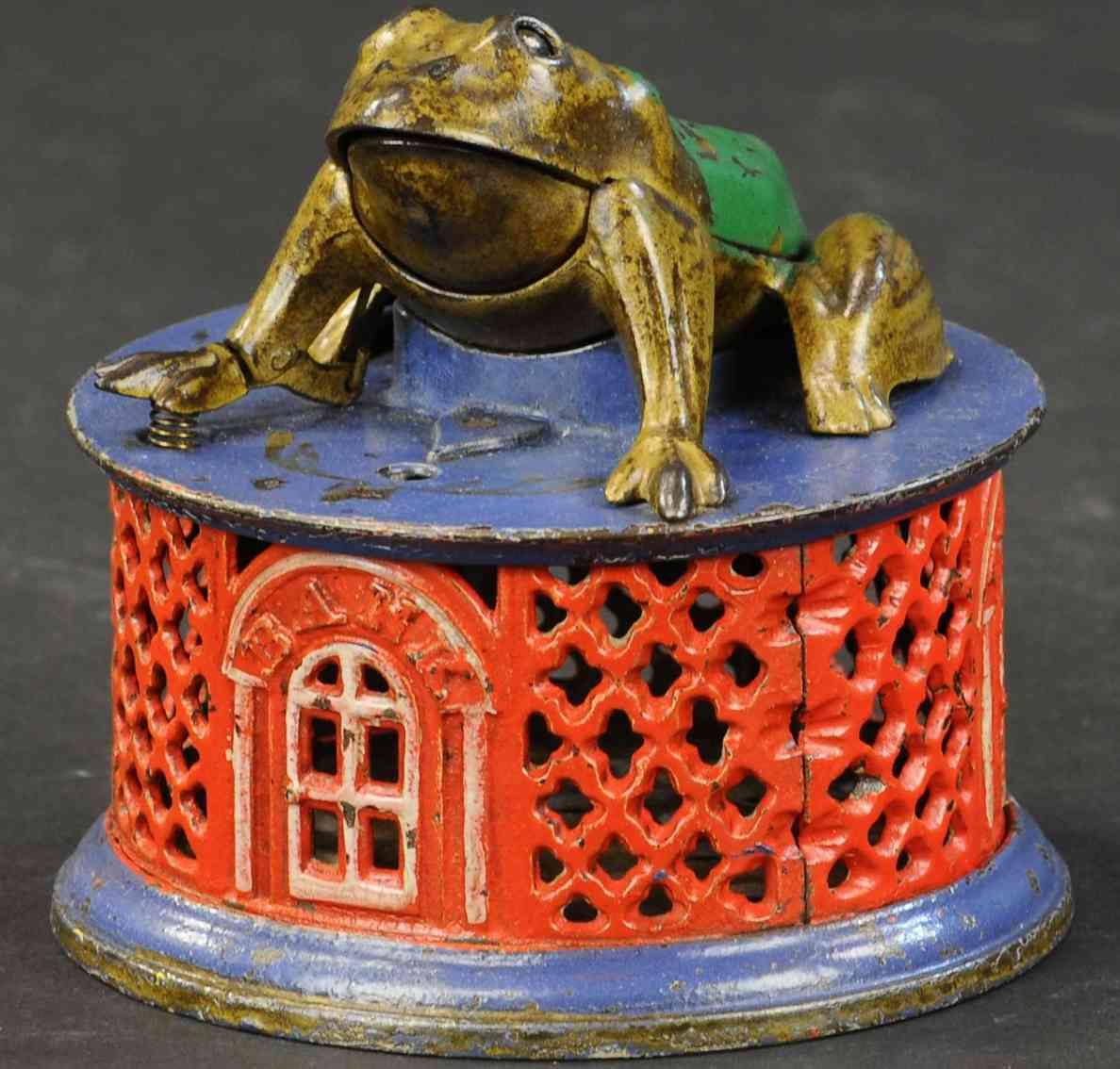 stevens co j & e 110 cast iron toy frog on lattice mechanical bank red blue gold