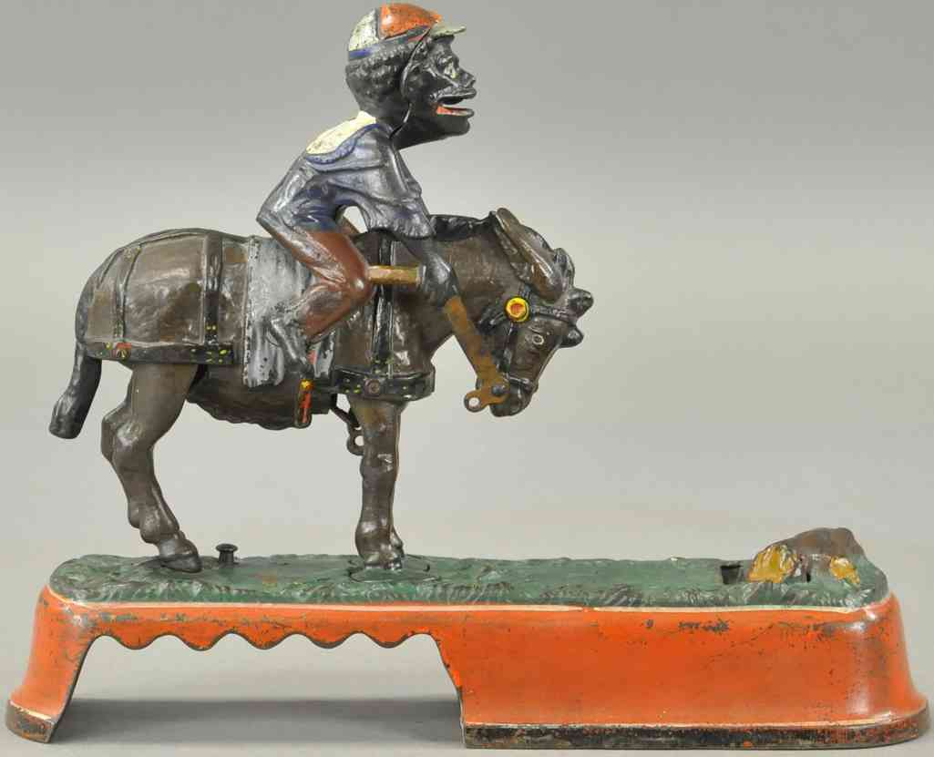stevens co j. & e. 329 cast iron toy still bank spise a mule boy on a bench red
