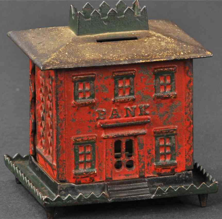 stevens co j & e cast iron toy crown bank with tower still bank green red