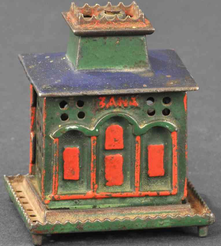 stevens co j & e cast iron toy crown bank with crown still bank green red blue