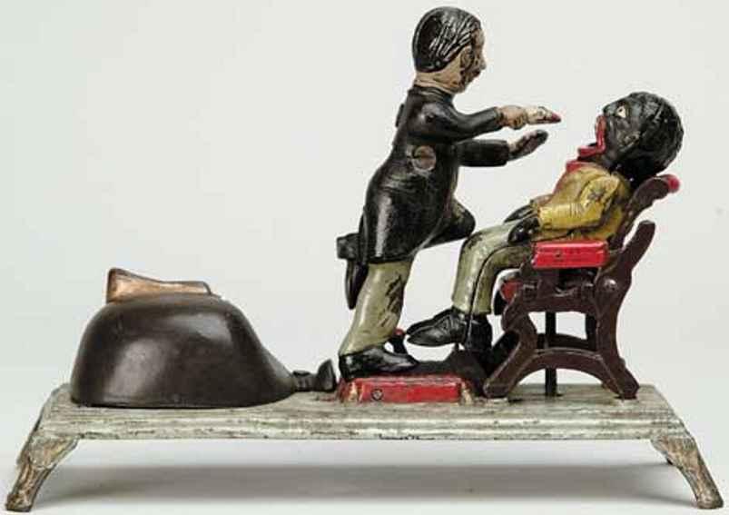 stevens co j & e dentist mechanical  bank cast iron toy