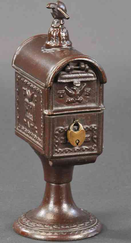 cast iron toy mailbox as bank with eagle finial