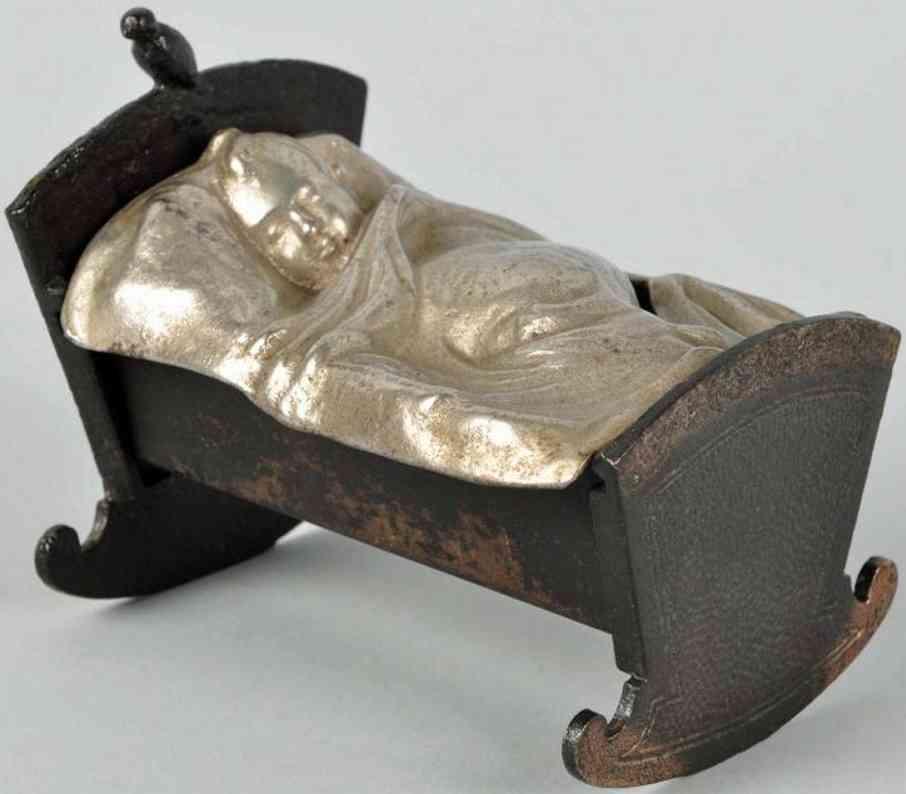 Baby in cradle still bank