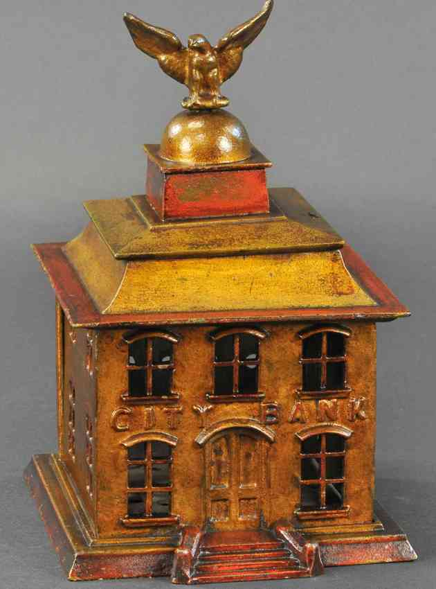 cast iron toy large city bank with eagle as finial