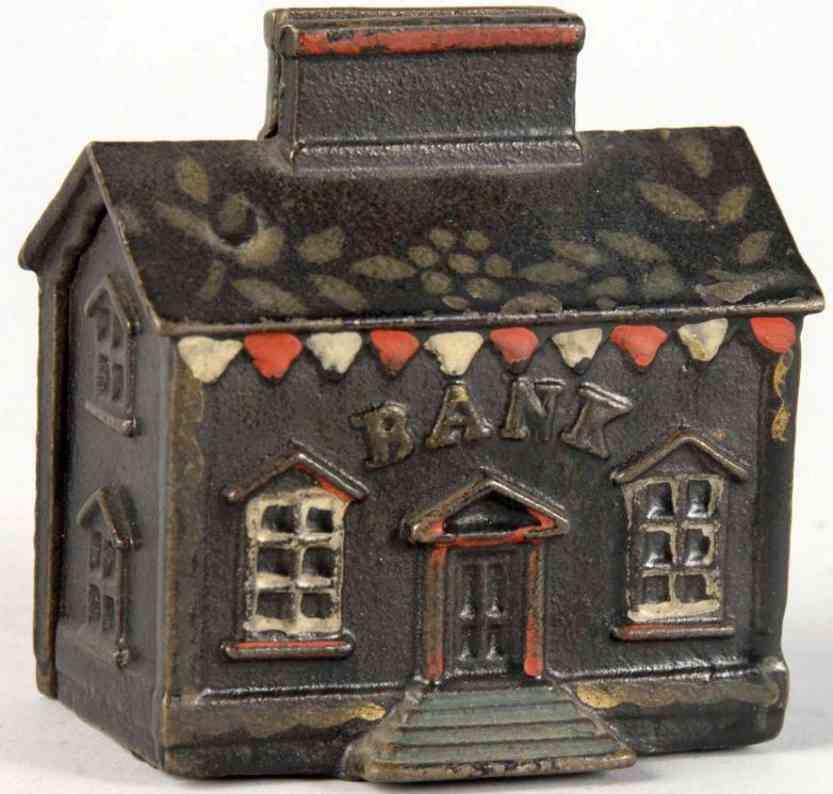 Gusseisernes Haus mit Kamin als Spardose