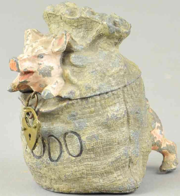 pig in money bag, spelter still bank